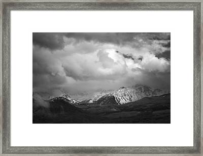 Clouds Over The Top Framed Print by Jon Glaser