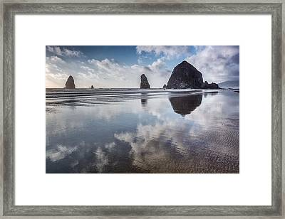 Clouds Reflecting Framed Print by Jon Glaser
