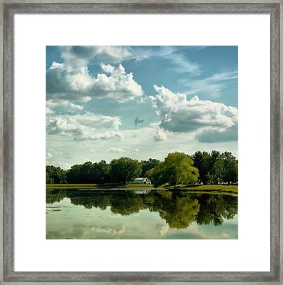 Cloudy Reflections Framed Print by Kim Hojnacki