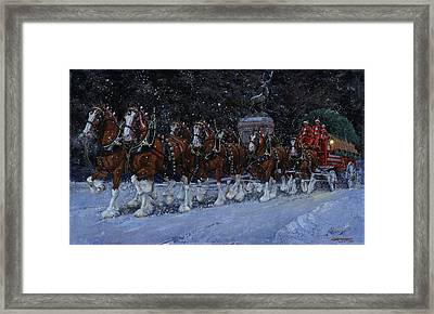Clydesdales Coming Through The Gate Snowing Framed Print by Don  Langeneckert