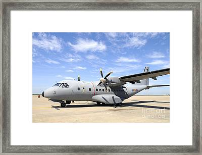 Cn-235 Transport Aircraft Framed Print by Riccardo Niccoli