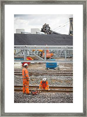 Coal Stock Piles At Drax Power Station Framed Print by Ashley Cooper