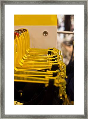 Coat Hangers Framed Print by Carole Hinding