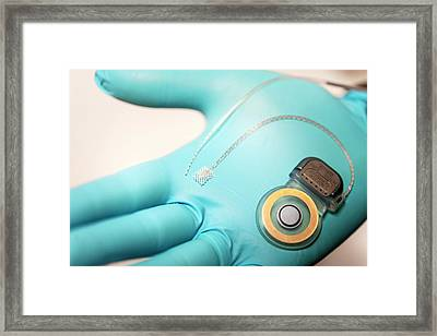 Cochlear Implant Framed Print by Arno Massee