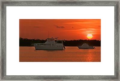 Cabin Cruiser And Red Sunset Over Harbour Framed Print by Ginger Wakem