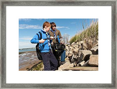 Collecting Litter Framed Print by Matthew Oldfield