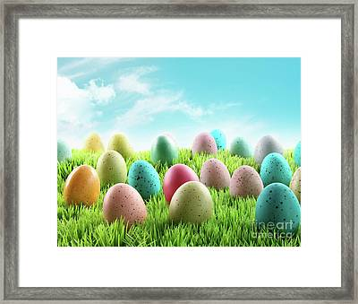 Colorful Easter Eggs In A Field Of Grass Framed Print by Sandra Cunningham