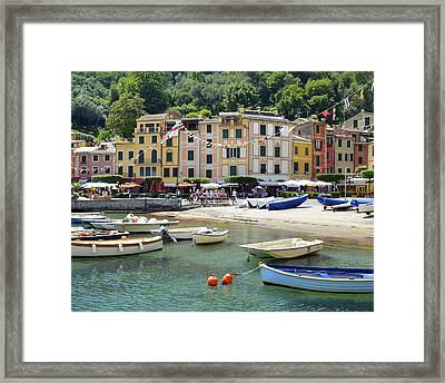 Colorful Fishing Village Framed Print by Corinne Rhode