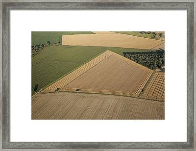 Combine Harvesters At Work Framed Print by Laurent Salomon