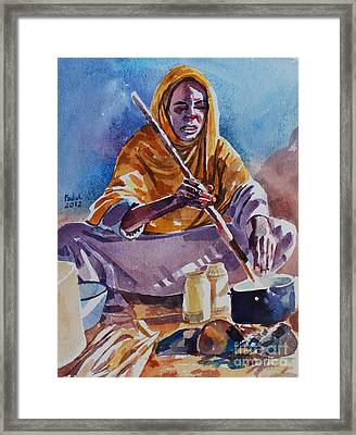 Cooking Morning Framed Print by Mohamed Fadul