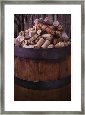 Corkscrew And Corks On Wine Barrel Framed Print by Garry Gay