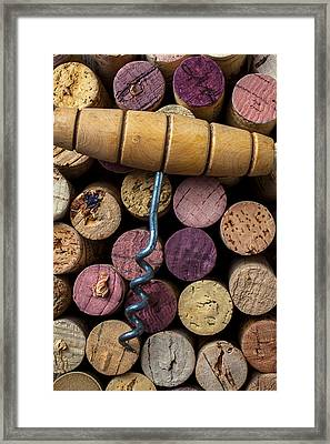 Corkscrew On Top Of Wine Corks Framed Print by Garry Gay