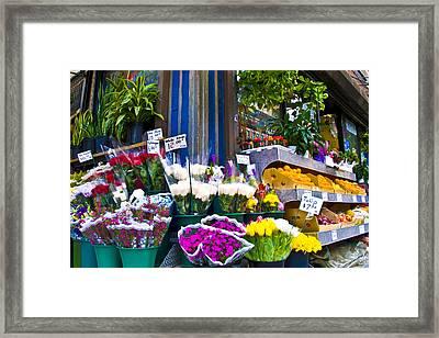 Corner Flower Stand Framed Print by Larry Goss