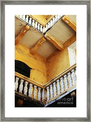 Corners In Cartagena Framed Print by John Rizzuto