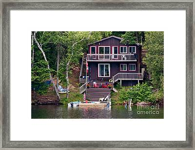 Cottage On The Water Framed Print by Les Palenik