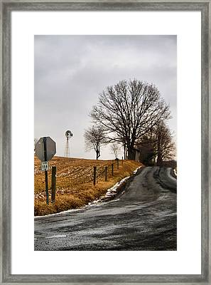 Country Road And Windmill In Ohio Framed Print by Dan Sproul