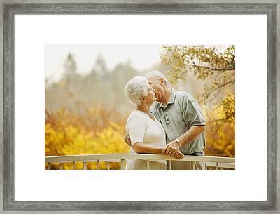 Couple Enjoy A Kiss Framed Print by Don Hammond