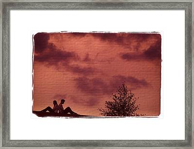 Couple Sitting Back To Back Framed Print by Don Hammond
