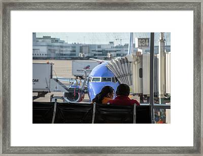 Couple Waiting At An Airport Framed Print by Jim West