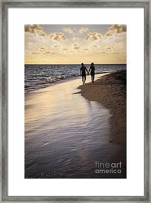 Couple Walking On A Beach Framed Print by Elena Elisseeva