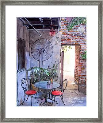 Courtyard Of The Napoleon House Framed Print by John Boles