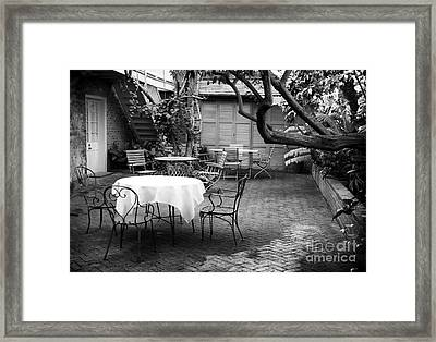 Courtyard Seating Framed Print by John Rizzuto