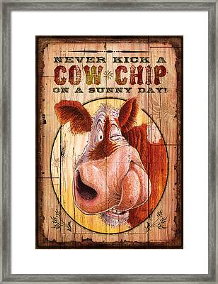 Cow Chip Framed Print by JQ Licensing