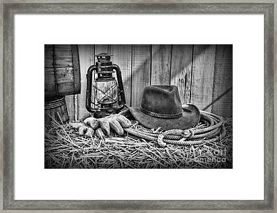 Cowboy Hat And Rodeo Lasso In A Black And White Framed Print by Paul Ward