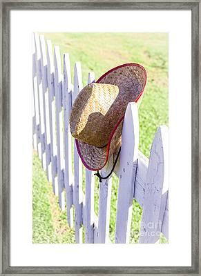 Cowboy Hat On Picket Fence Framed Print by Edward Fielding