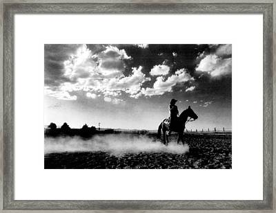 Cowboy On Horse Framed Print by Retro Images Archive