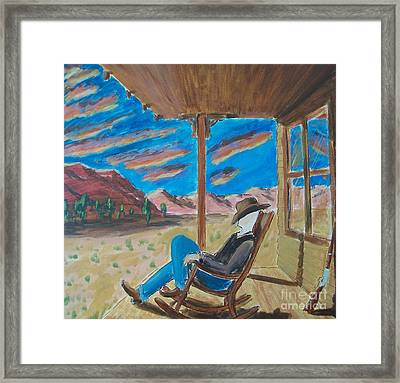 Cowboy Sitting In Chair At Sundown Framed Print by John Lyes