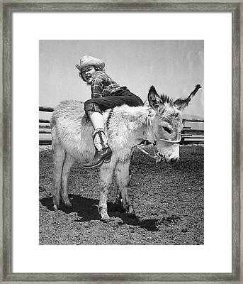 Cowgirl Backwards On A Donkey Framed Print by Underwood Archives
