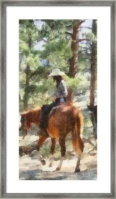 Cowgirl Horseback Riding Framed Print by Dan Sproul
