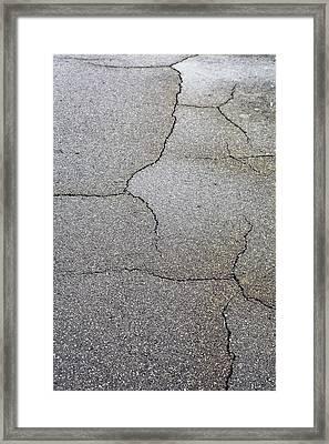 Cracked Tarmac Framed Print by Tom Gowanlock