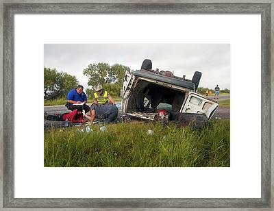 Crash Victim Being Treated And Questioned Framed Print by Jim West