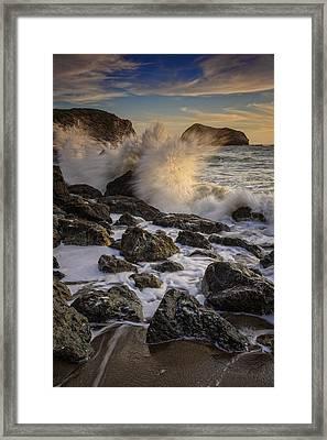 Crashing Sunset Framed Print by Rick Berk
