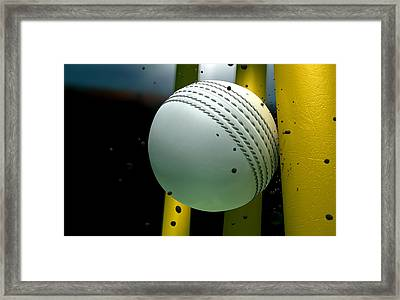 Cricket Ball Striking Wickets With Particles At Night Framed Print by Allan Swart