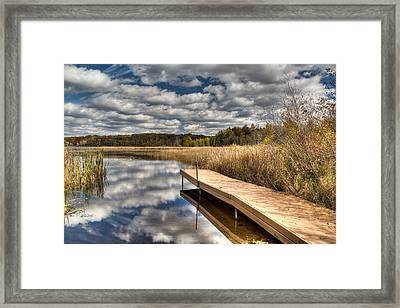Crooked Lake Launch Framed Print by Jeffrey Ewig