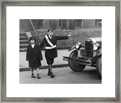 Crossing Guard Stops Traffic Framed Print by Underwood Archives