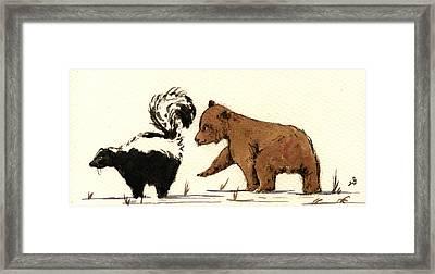 Cub Bear Playing With Skunk Framed Print by Juan  Bosco