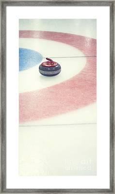 Curling Stone In A Distance Framed Print by Priska Wettstein