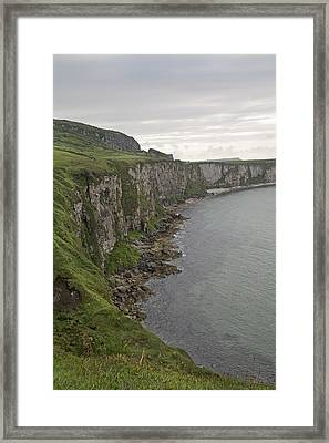 Carrick-a-rede Cliffs Framed Print by Betsy Knapp