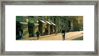 Cyclists And Pedestrians On A Street Framed Print by Panoramic Images