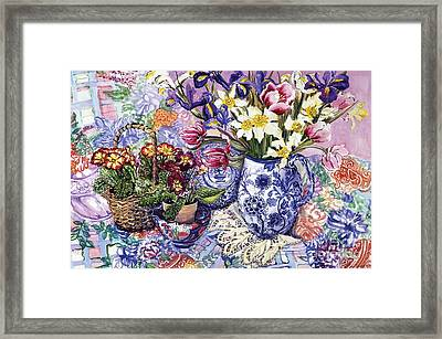 Daffodils Tulips And Iris In A Jacobean Blue And White Jug With Sanderson Fabric And Primroses Framed Print by Joan Thewsey