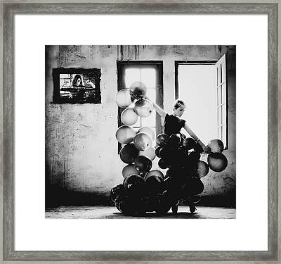 Dancing With Loneliness Framed Print by Yugie Potret