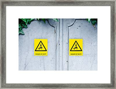 Danger Of Death Framed Print by Tom Gowanlock
