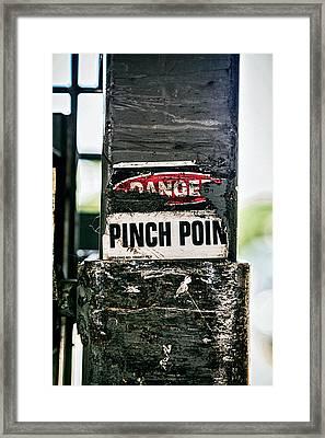 Danger Pinch Point Framed Print by Sennie Pierson