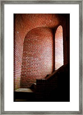 Dark Brick Passageway Framed Print by Frank Romeo