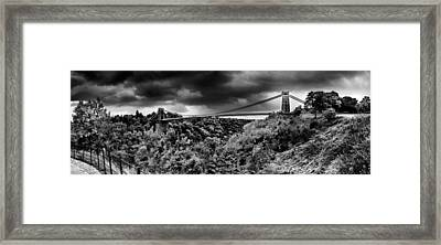 Dark Clouds Over A Suspension Bridge Framed Print by Panoramic Images