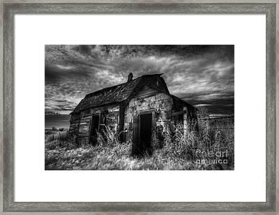 Dark Skies On The Prairie Framed Print by Dan Jurak